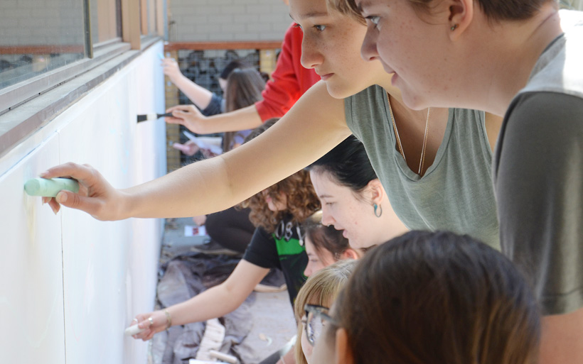 students sketching mural